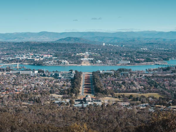 Urban area, Sky, Metropolitan area, City, Cityscape, Aerial photography, Hill, Tree, Cloud, Infrastructure, Mountain, Photography, Bird's-eye view, Residential area, Metropolis, Landscape, Suburb, Bridge, Architecture, Skyline, ANZAC Parade