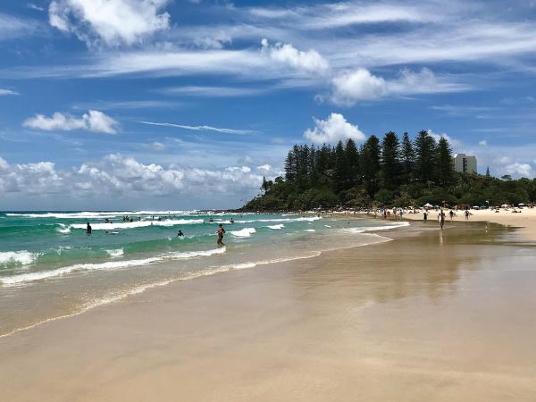 Body of water, Beach, Sky, Sea, Coast, Shore, Ocean, Water, Cloud, Daytime, Coastal and oceanic landforms, Wave, Sand, Tree, Vacation, Bay, Wind wave, Tropics, Caribbean, Summer, Beach, Greenmount Beach, Rainbow Bay, Coolangatta, Coolangatta Beach, Kirra, Nobby Beach