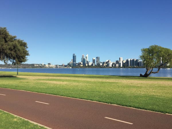 Daytime, Skyline, City, Sky, Grass, Natural landscape, Human settlement, Urban area, Tree, Sport venue, River, Metropolitan area, Real estate, Neighbourhood, Cityscape, Park, Urban design, Architecture, Lawn, Residential area, South Perth Foreshore, City of Perth, Swan River, Fremantle