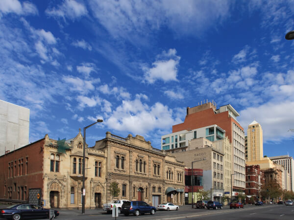 Building, Metropolitan area, Daytime, City, Sky, Residential area, Town, Neighbourhood, Architecture, Human settlement, Urban area, Mixed-use, Landmark, Metropolis, Facade, Property, Downtown, Public space, Commercial building, Plaza, North Terrace, Bonython Hall