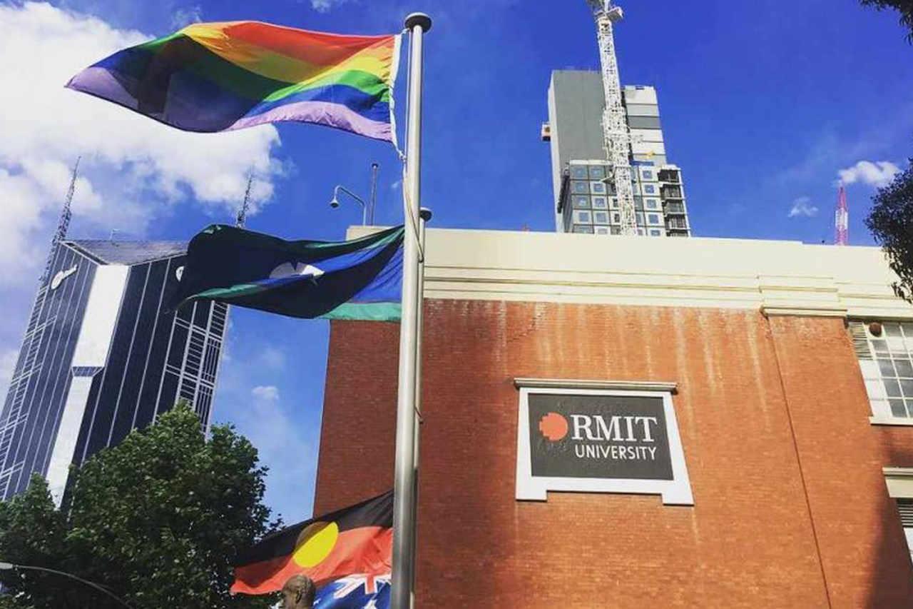 Flag, Sky, Architecture, Metropolitan area, Banner, Building, City, Advertising, RMIT University