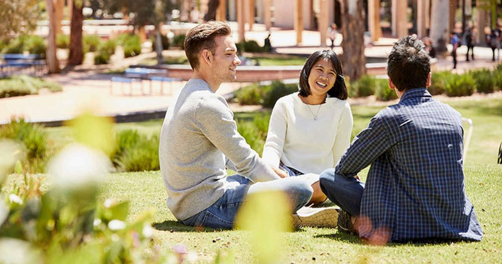 People, Sitting, Yellow, Friendship, Community, Grass, Conversation, Real estate, Spring, Interaction, Event, Smile, Leisure, Adaptation, Happy, White-collar worker, Campus, Lawn, University of Canberra, King's College London, Study skills
