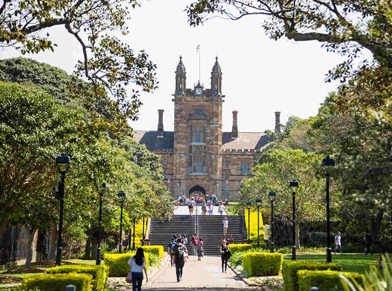 Landmark, Tree, Building, Town, Architecture, Public space, City, Urban area, Sky, Spring, Botany, College, Grass, Tourism, Woody plant, Plant, Campus, University, Garden, Street, University of Sydney, The University of Sydney, The University of Sydney