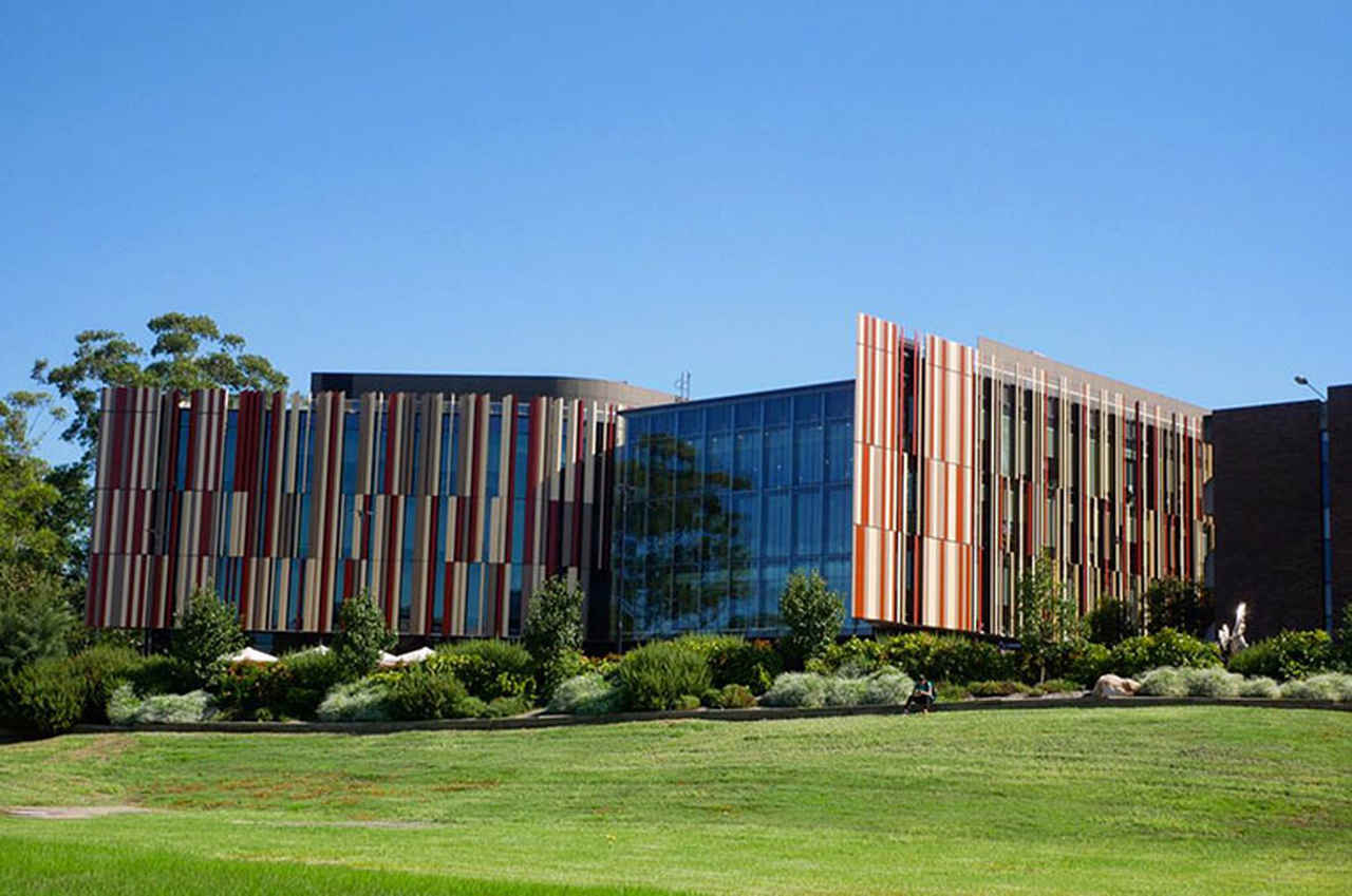Architecture, Property, Building, Botany, Real estate, Corporate headquarters, Facade, House, Campus, Grass, Tree, Home, City, Commercial building, Estate, Mixed-use, Macquarie University, University