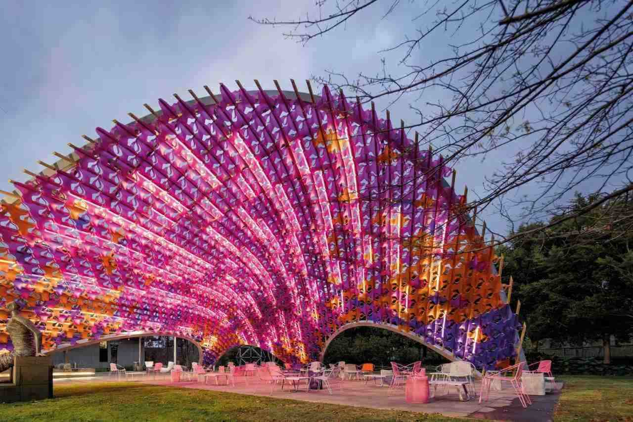 Landmark, Tourist attraction, Light, Tree, Sky, Architecture, Magenta, Fun, Recreation, Ferris wheel, Plant, National Gallery of Victoria, Architecture, Pavilion, Design