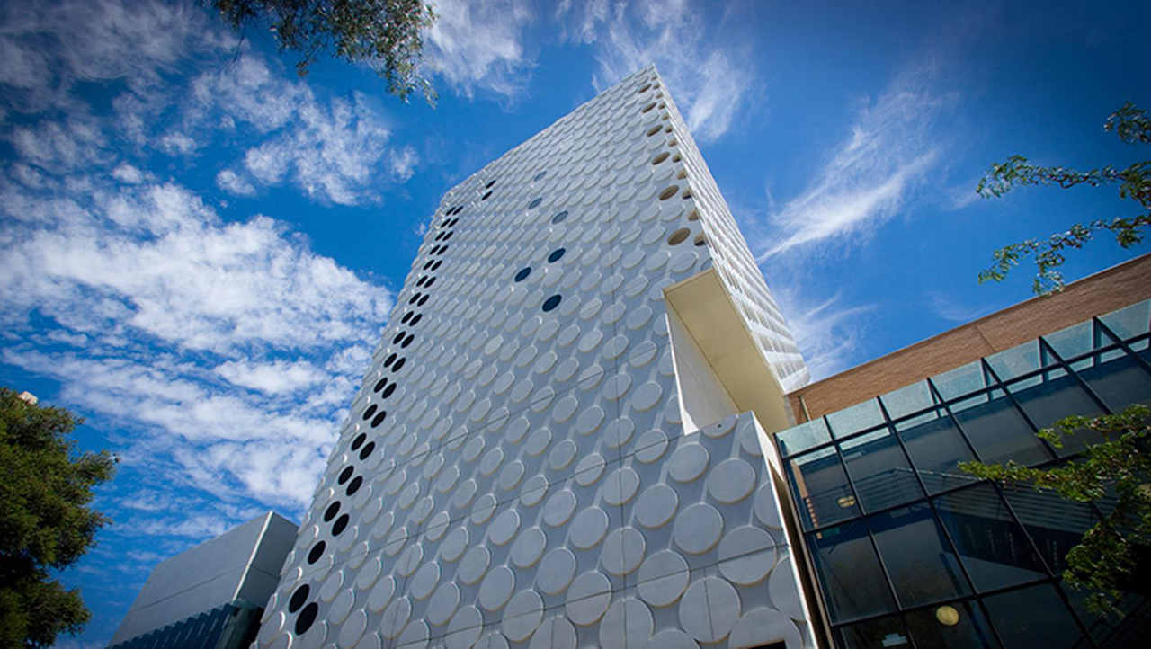 Sky, Blue, Architecture, Daytime, Building, Metropolitan area, Tower block, Property, Commercial building, Skyscraper, Condominium, Facade, Cloud, Urban area, City, Real estate, Corporate headquarters, Headquarters, Material property, Tower, Swinburne University of Technology, University, Swinburne University of Technology