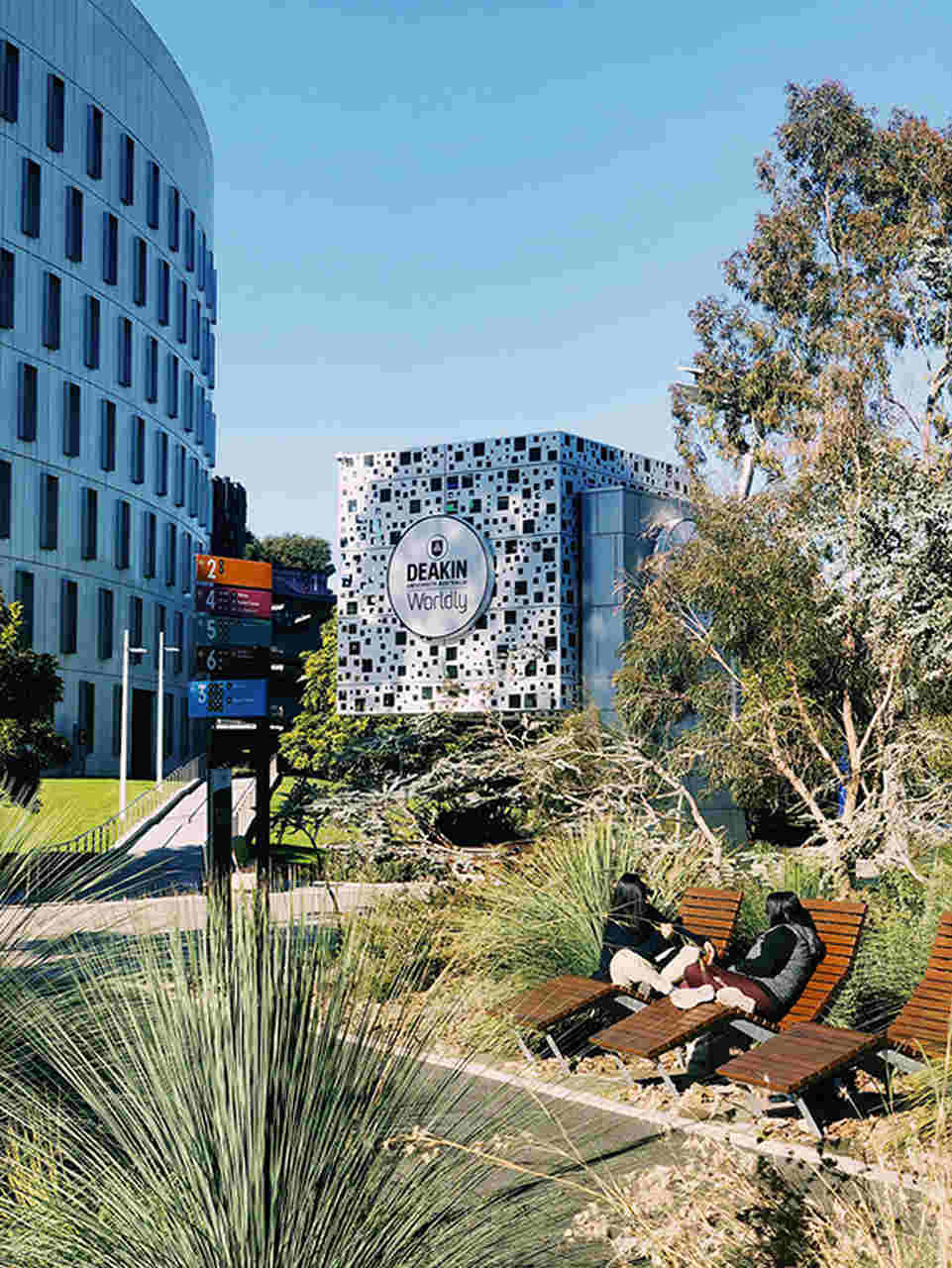 Architecture, Urban area, Daytime, Tree, Art, City, Condominium, Building, Sculpture, Real estate, Neighbourhood, Landscape, Residential area, Plant, House, Mixed-use, Deakin University, International student