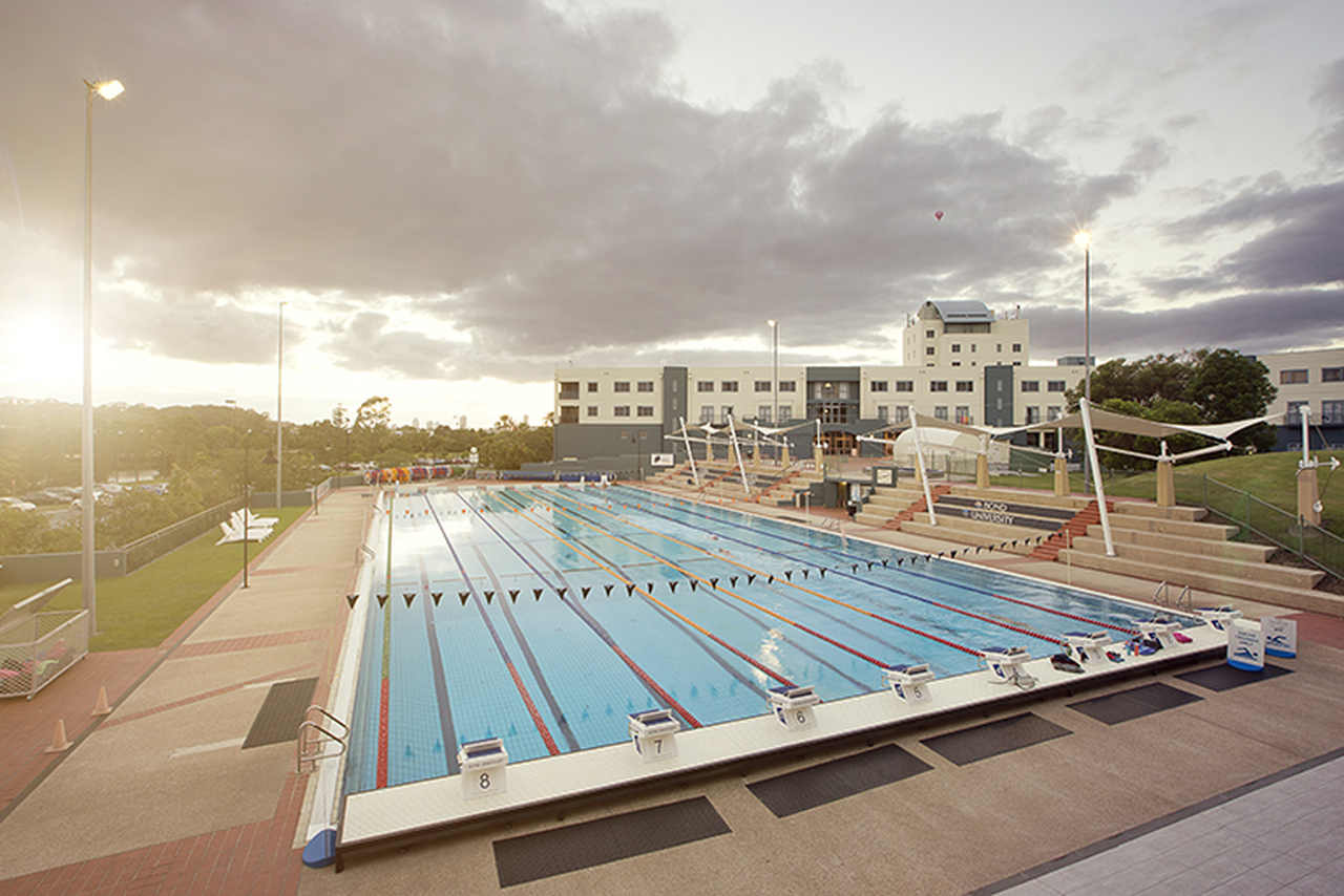 Swimming pool, Sky, Leisure centre, Property, Roof, Real estate, Sunlight, Architecture, Cloud, Building, Technology, Sport venue, Leisure