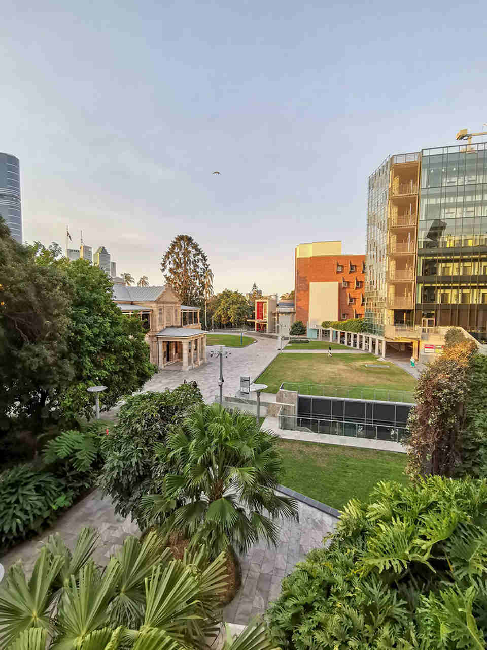Sky, City, Urban area, Architecture, Building, Human settlement, Property, Daytime, Town, Metropolitan area, Real estate, Tree, Grass, Botany, Residential area, Urban design, Mixed-use, Cloud, House, Neighbourhood, QUT Gardens Point Campus, The University of Queensland