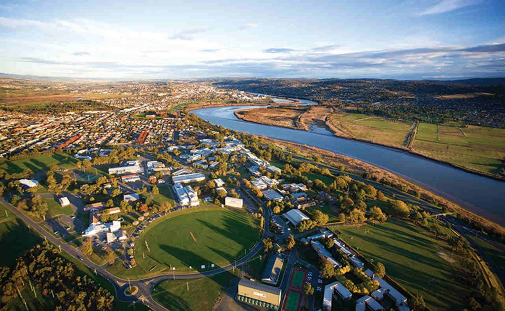 Aerial photography, Bird's-eye view, Residential area, Suburb, Photography, Landscape, Sky, Urban area, Urban design, Land lot, Metropolitan area, City, River, Launceston, University of Tasmania, The University of Western Australia, Monash University, University, Campus