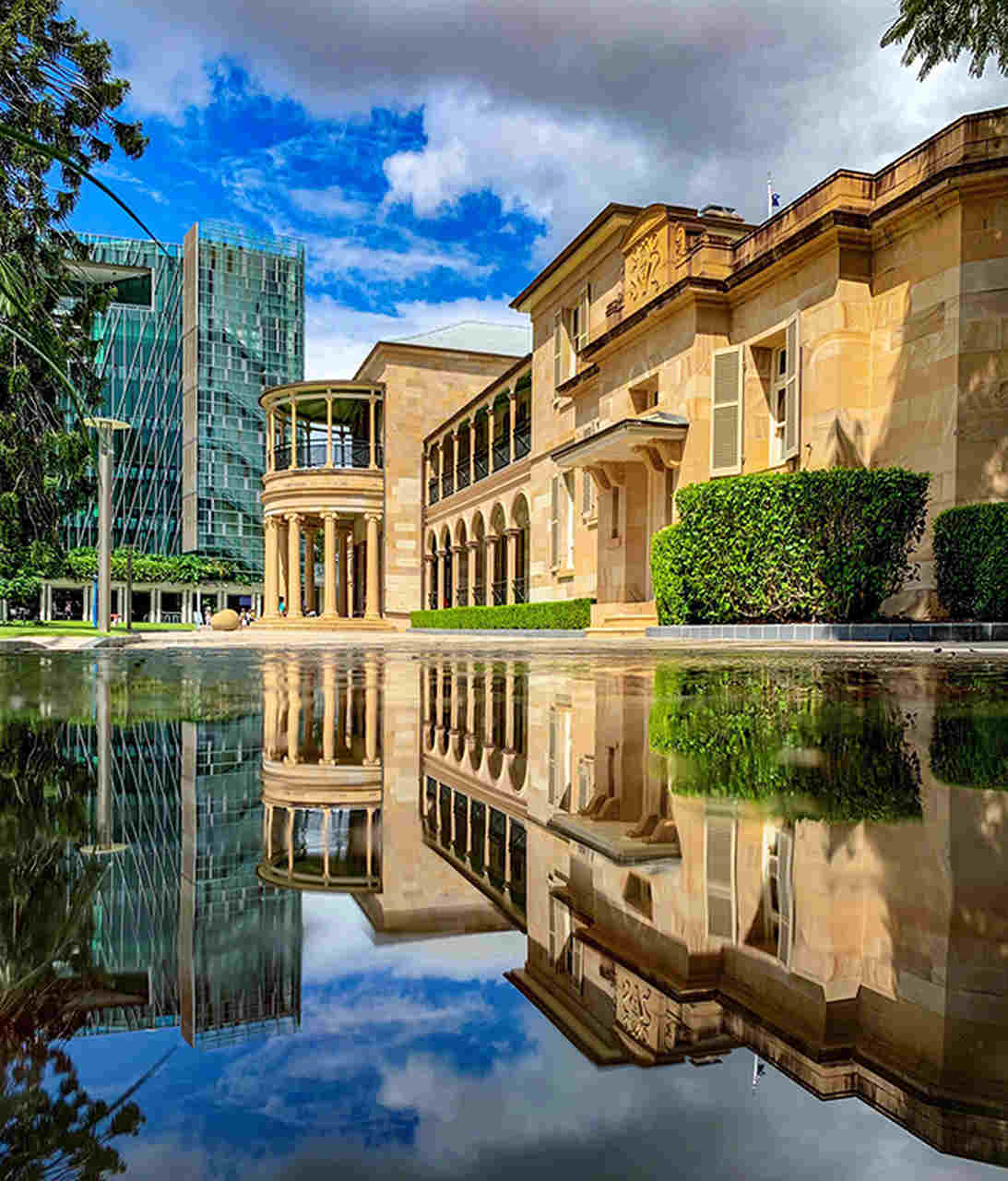 Reflection, Water, Building, Property, Architecture, Waterway, Reflecting pool, Sky, Real estate, House, Condominium, Home, Mixed-use, Estate, Facade, Canal, Apartment, Room, Residential area, City, QUT Gardens Point Campus