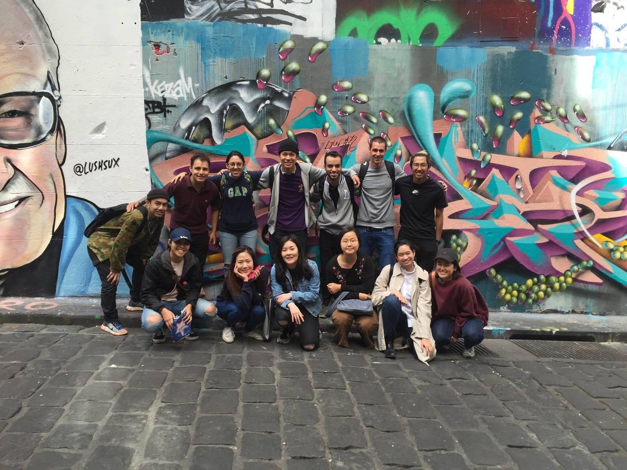 Street art, Graffiti, Social group, Art, Wall, Mural, Snapshot, Youth, Urban area, Eyewear, Photography, Glasses, Visual arts, Street, Leisure
