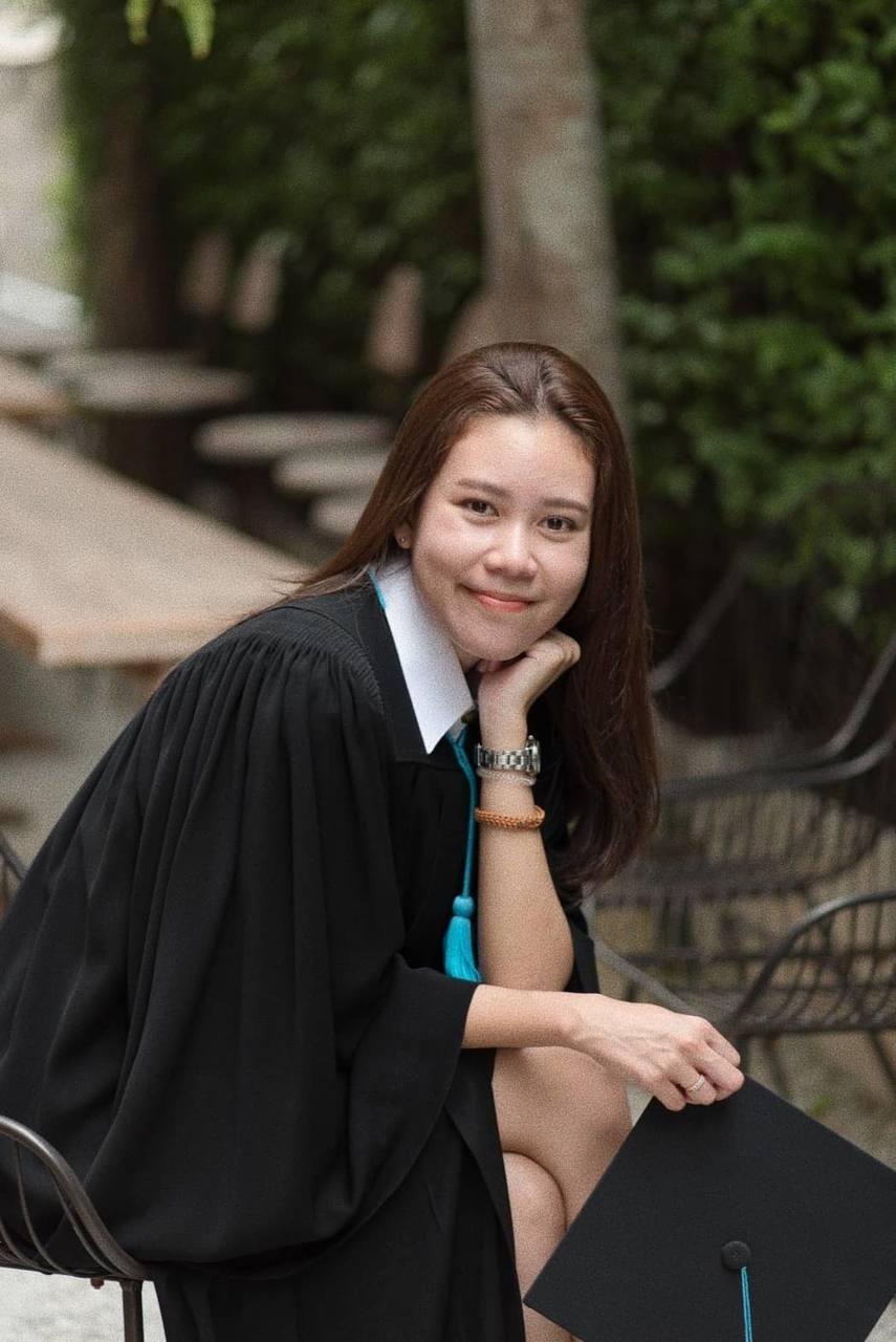 Academic dress, Lip, Photography, Graduation, Outerwear, Tree, Student, Long hair, Portrait photography, Academic dress