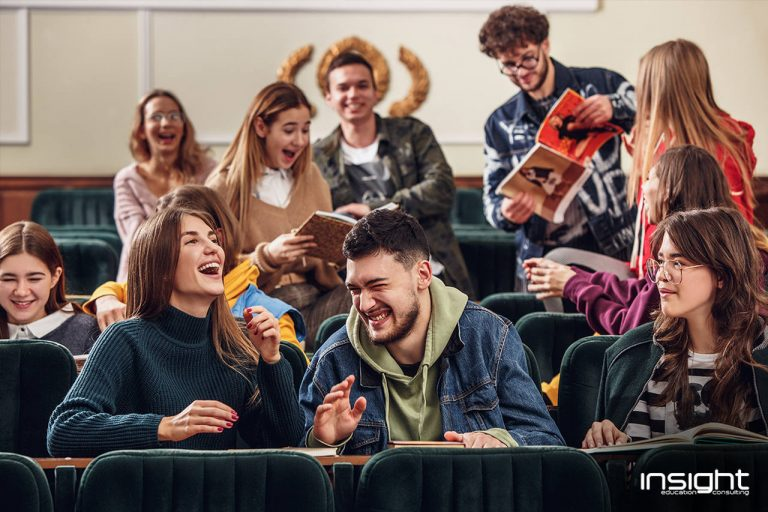 Hair, Face, Mouth, People, Social group, Facial expression, Sharing, Youth, Jacket, Conversation, Brown hair, Sweater, Laugh, Student, Education, College